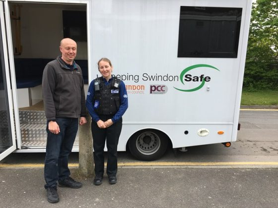 PCSO Sam Giles with a a parish Councillor at Covingham