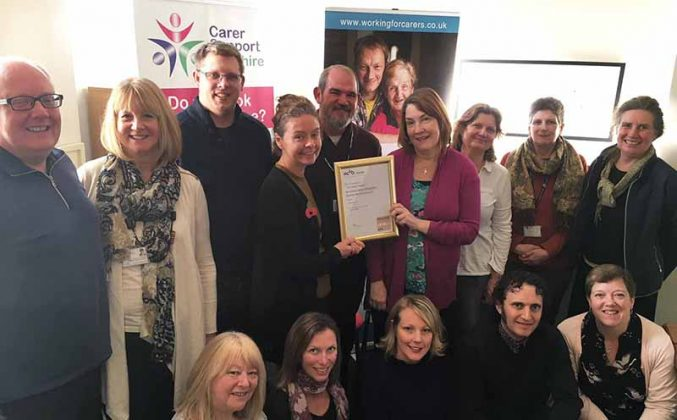 Pictured are some of the CSW team proudly showing their PQASSO certificate