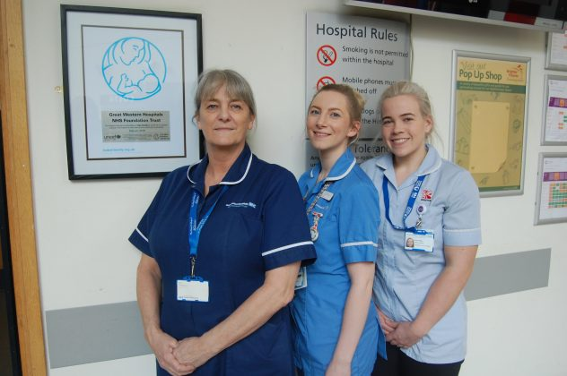 Cathy Gale, Lucia Szweda, Midwife, and Kirsty Wheeler, Student Midwife, in front of the new plaque in GWH's Atrium reception.