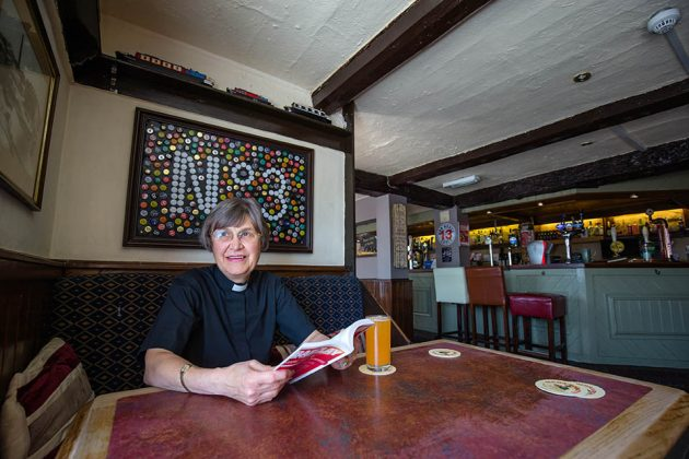 Reverend Patricia Robinson in the Ye Old 3 pub.