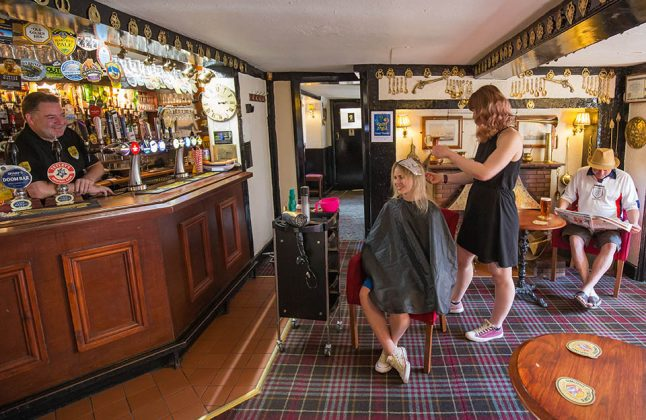 Hairdresser Vici Rogers and Lauren Owers in the Lord Eldon pub. Landlord Mark Gillick behind the bar.