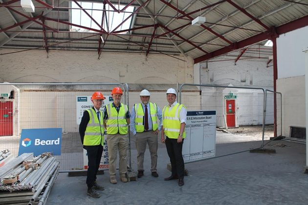 Dr Geraint Coles, Cllr Dale Heenan, Marc Bayley and Paul Bath outside Unit 11 of the Carriage Works on London Street