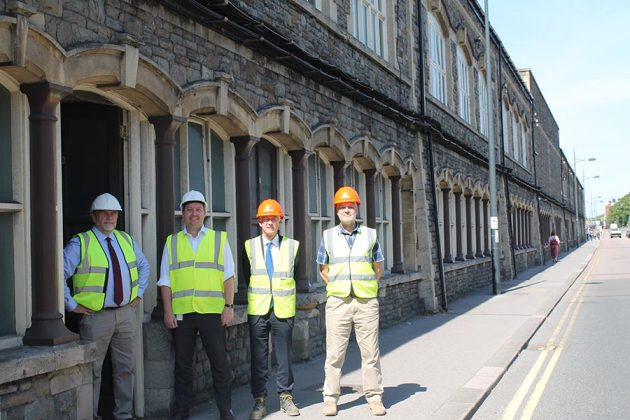 Cllr Dale Heenan, Dr Geraint Coles and Marc Bayley inside the ground floor of Unit 11 of the Carriage Works