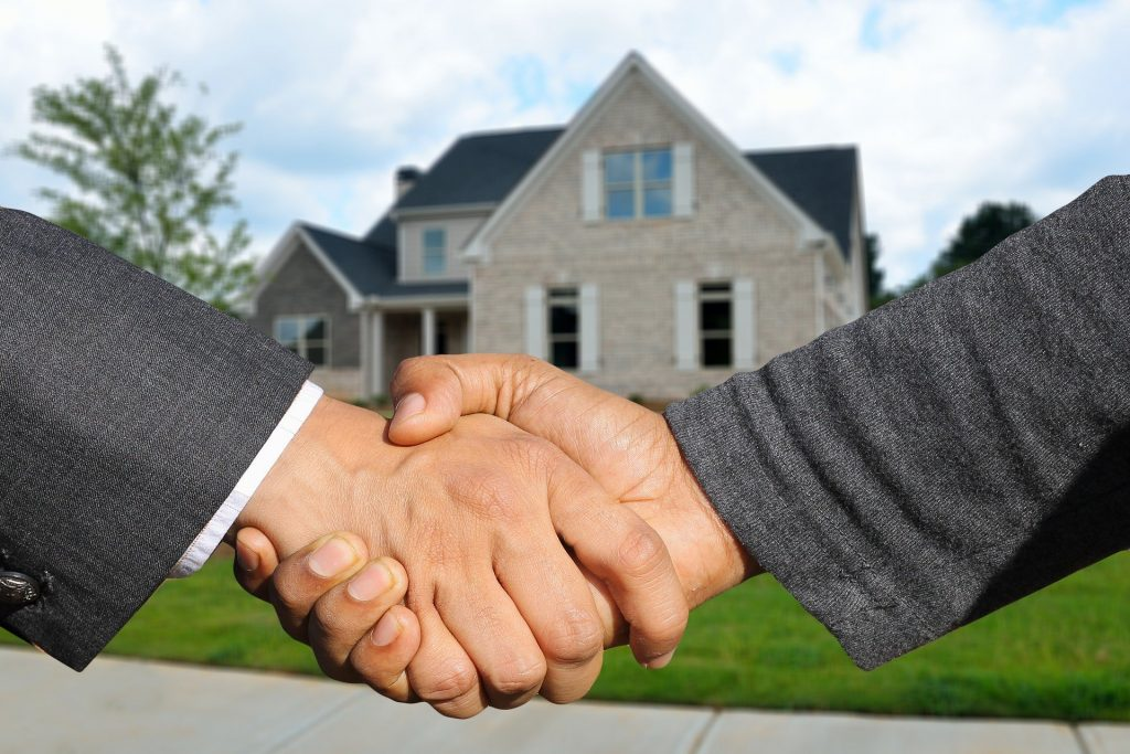 estate agents selling a home